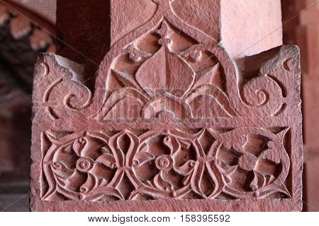 FATEHPUR SIKRI, INDIA - FEBRUARY 15 : Beautiful stone carvings on the wall in Fatehpur Sikri complex, Uttar Pradesh, India on February 15, 2016.
