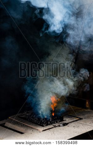 The Blacksmith Manually Forging The Molten Metal On The Anvil