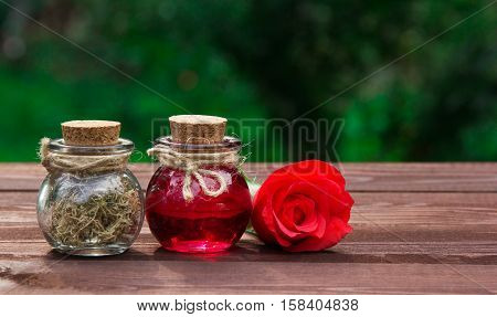 Aromatic rose oil and dried seaweed. Beauty and body care. Spa concept. Aromatherapy and massage. Copy space.