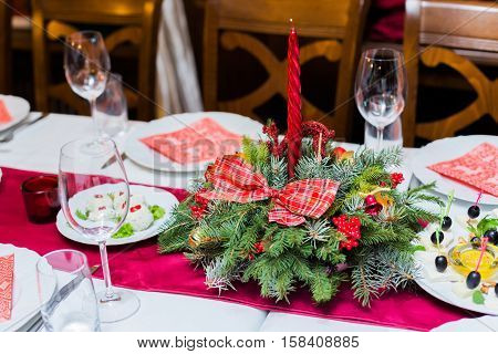 Christmas table place setting with christmas pine branchesribbon and bow. Xmas and New Year holidays background