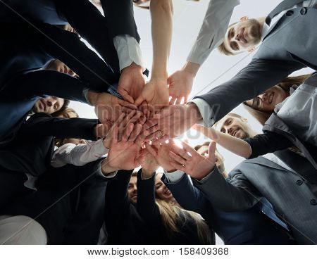 Large successfull business team showing unity with their hands t