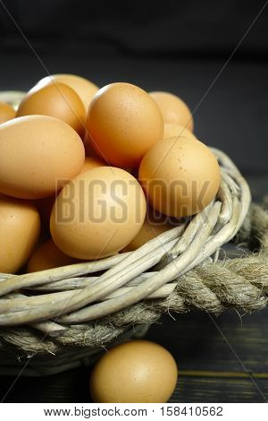 Organic brown chicken eggs from free-range farm in wicked basket