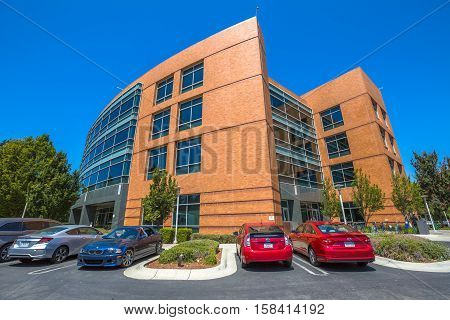 Mountain View, California, United States - August 15, 2016: Google Building 1950 with cars parked in front. Google is a multinational corporation specializing in Internet services and products.