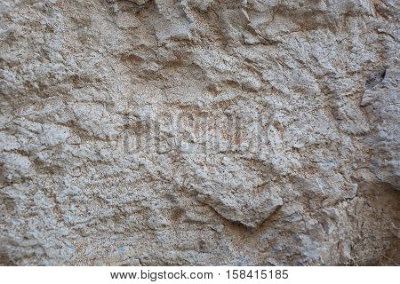 Stone white with irregularities on its surface