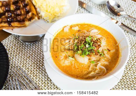 authentic singaporean laksa with a lot of seafoods