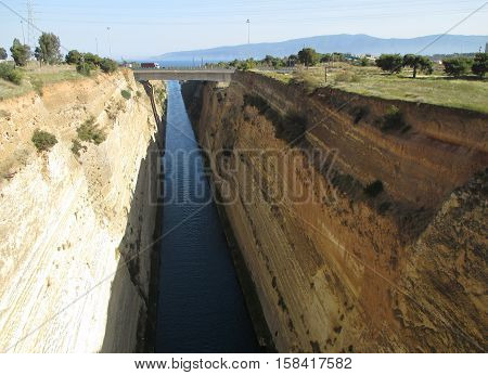 Awesome view of famous Corinth Canal with motorway bridge, Corinthia in Greece