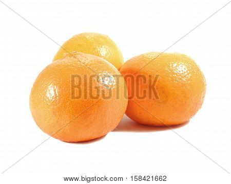 Closed up three ripe bright color oranges isolated on white background