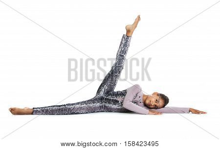 Little Girl Doing Gymnastics. Flexible Girl Lying On The Floor