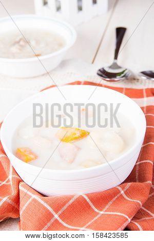 ginataan or mixture of banana, taro, pumpkin, rice balls and sago in coconut milk