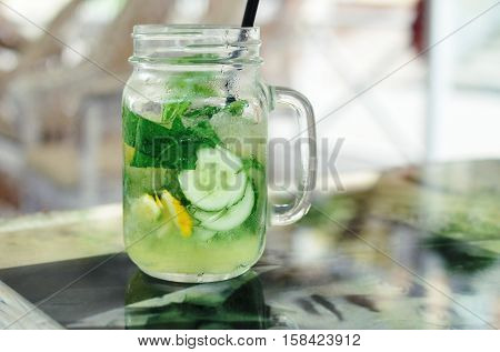 Cucumber lemonade on a table with printed image of Sergei Yesenin at a cafe.
