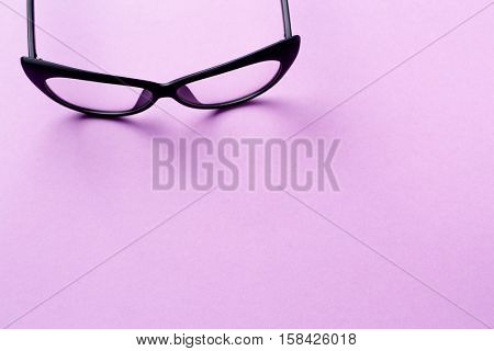 Black glasses with transparent lenses