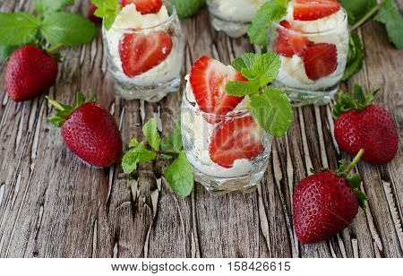 Strawberries With Cream Or Tiramisu . Selective Focus