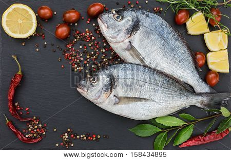 Two Fresh Dorado Fish On Slate Cutting Board. Top View, Copy Space
