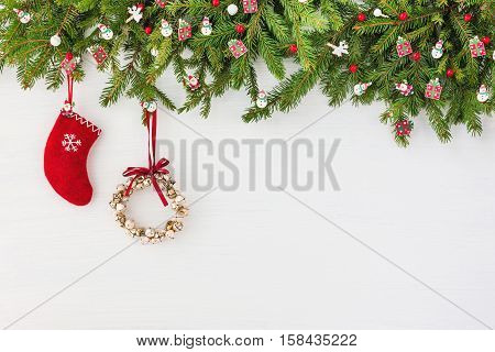 Christmas Background. Decorated Christmas Tree, Christmas Wreath And Red Sock On White Wooden Backgr