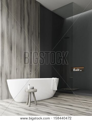Side View Of A Bathroom With A Tub And A Wooden Wall