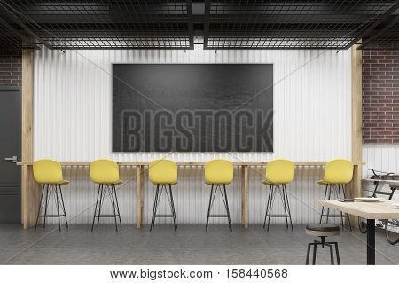 Cafe Interior With A Chalkboard And A Row Of Yellow Chairs