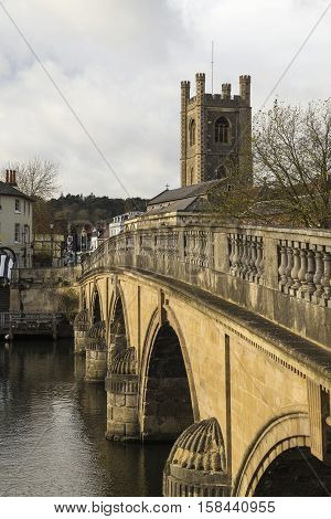 An image of a river bridge leading to church shot in Henley-On-Thames Oxfordshire England UK