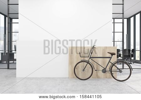 Office with a white wall behind a reception counter. A bicycle is standing near it. A conference room in the background. 3d rendering. Mock up