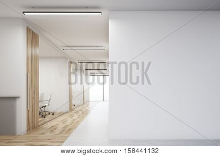 Office With Blank Wall And Row Of Meeting Rooms