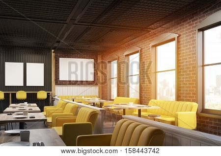 Cafe interior with yellow and beige sofas wooden tables and brick wall with posters hanging on them. 3d rendering. Mock up. Toned image