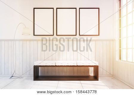 Bench In A Room With Three Framed Posters, Toned