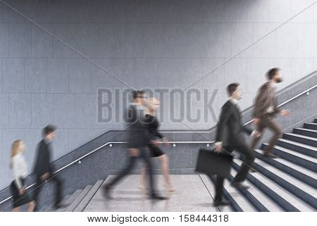 Side view of business people climbing a stair in a building on a morning. Concept of business person's routine. Mock up