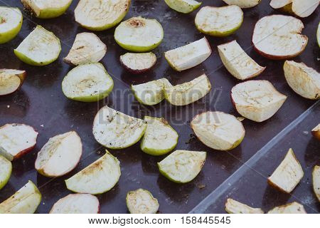 Dried Fruits Are Dried On A Glass Surface. Dried Apples, Cut Into Slices