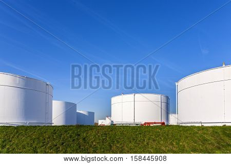 White Tanks In Tank Farm With Blue Sky