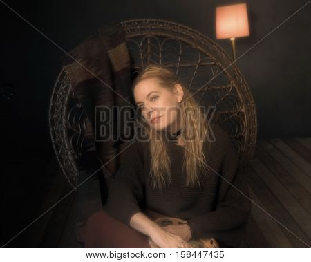 Retro 1970S Female Musician With Tambourine Sitting On Chair In Living Room.