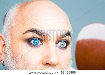 Senior Man With Blue Lens