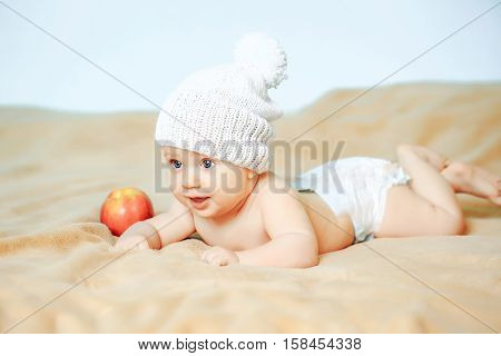 Little Boy In White Hat With Apple