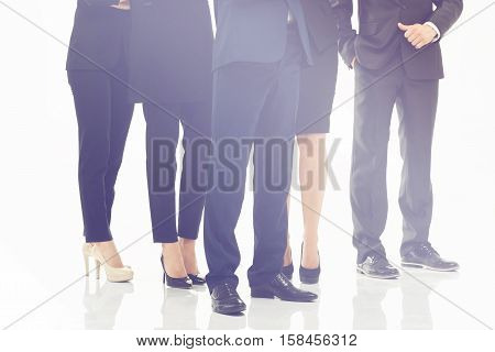 closeup of feet of staff standing behind each other.photo on a white background. the concept of reliability