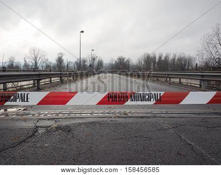 Local Police line (Polizia Municipale in Italian) do not cross. Bridge access blocked for flood risk