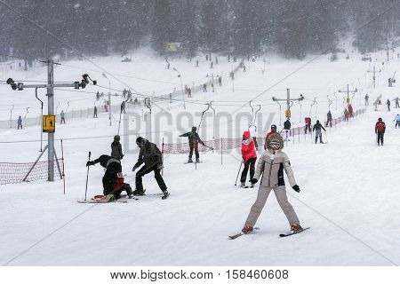 POLAND ZAKOPANE - JANUARY 04 2015: Skiing near Nosal Peak (High Tatra Mountains) in Zakopane. Town known as the winter capital of Poland. It is a popular destination for mountaineering skiing and qualified tourism.