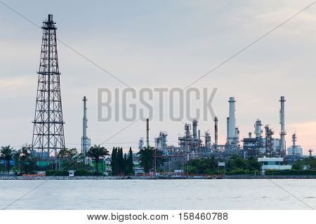 Refinery river front, heavy industrial background after sunset