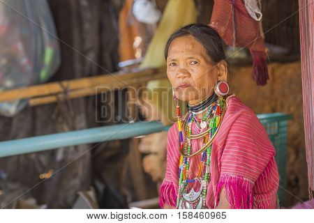CHIANG RAI THAILAND - November 06 : Unidentified Long Neck Karen hill tribe woman on November 06 2016 in Chiang Rai Thailand.