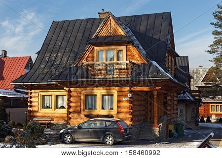 POLAND ZAKOPANE - JANUARY 03 2015: Traditional wooden cottage house in Zakopane. Town known as the winter capital of Poland. It is a popular destination for mountaineering and skiing.