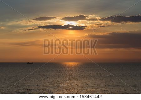 Ship on the seacoast with sunset sky background, natural landscape