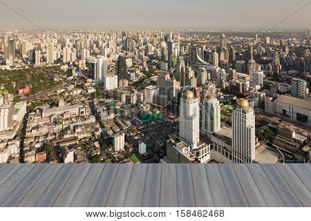 Opening wooden floor, Bangkok city central business downtown aerial view, Thailand