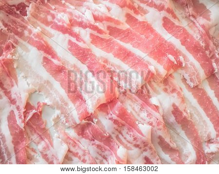 So many raw bacon to be cooked