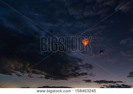 Hot Air Balloons fly over the city of Albuquerque, New Mexico during the mass ascension at the annual International Hot Air Balloon Fiesta in October, 2016