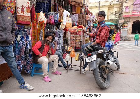 PUSHKAR, INDIA - FEBRUARY 17: People walk around downtown in Pushkar, India. The city is one of the five sacred dhams for devout Hindus, in Pushkar, Rajasthan, India on February 17, 2016.