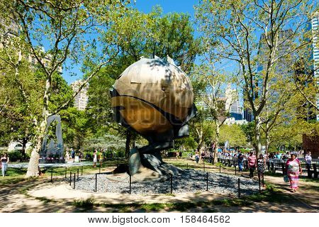 NEW YORK,USA - AUGUST 22,2016 : The Sphere sculpture, damaged during the September 11 attacks and now placed at Battery Park in downtown Manhattan