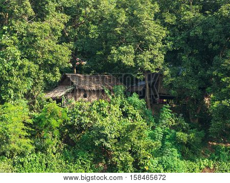 Traditional straw house at a tropical forest in Mrauk U an ancient town in the Rakhine State of Myanmar.