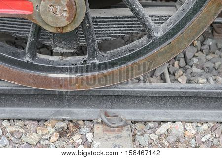 Steam train wheels closeup,  classic vintage in former on railroad tracks