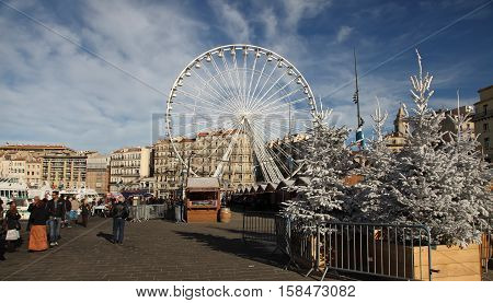 France Marseille - November 19 2015: Tradishional Christmas market with ferris wheel in Old port (Vieux-Port). Marseille is France's largest city on the Mediterranean coast and largest commercial port.