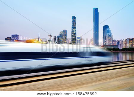 High speed train in urban background Guangzhou China.