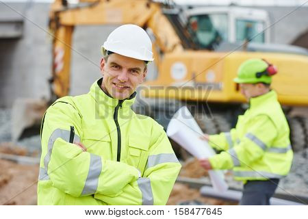 Engineer builders at construction site