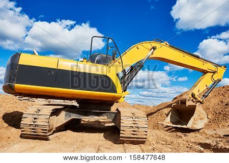 Loader excavator at sandpit earthmoving works