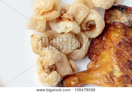 Streaky Pork With Crispy Crackling And Grilled Chicken Leg Ioslated On White Background Close-up. Ho